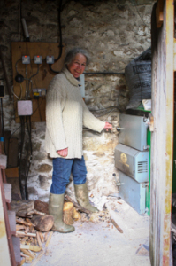 Ruth attending to the log boiler